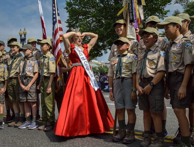 Miss Washington D.C., Katelynne Cox, makes a funny face while posing with Boy Scout troop 55 before the start of the National Independence Day Parade in Washington, D.C. on July 4, 2019. (Photo by Bill O'Leary/The Washington Post)