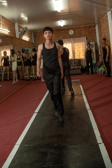 A male student from the Sun Model agency practices on the catwalk during a training session at the school on March 31, 2014 in Phnom Penh, Cambodia. (Photo by Omar Havana/Getty Images)