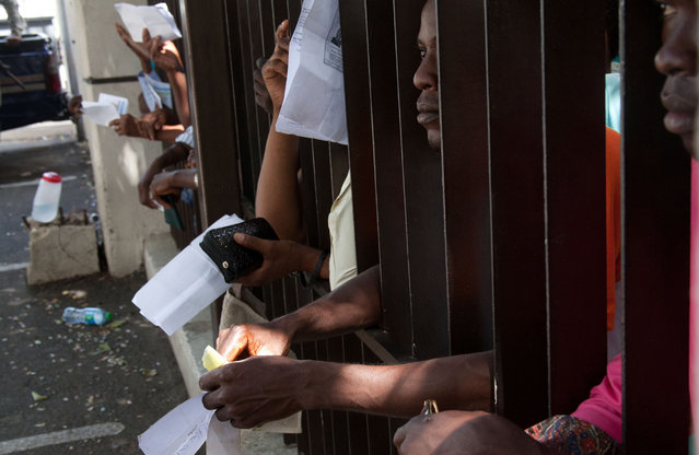 Haitian immigrants wait their turn to register for legal residency at the Interior Ministry in Santo Domingo, Dominican Republic, Tuesday, June 16, 2015. The head of the immigration agency in the Dominican Republic says the country is ready to resume deporting non-citizens without legal residency after putting the practice on hold for a year. (AP Photo/Tatiana Fernandez)