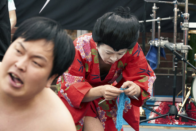 "The Japanese team Giga Body Metal perform in the Heavy Metal Knitting world champions with a show featuring crazy sumo wrestlers and team leader Manabu Kaneko dressed in a traditional Japanese kimono knitting , Thursday, July 11, 2019 in Joensuu, Finland. With stage names such as ""Woolfumes"", ""Bunny Bandit"" and ""9 Needles"", the goal was quite simple: to showcase their knitting skills whilst dancing to heavy metal music in the most outlandish way possible. (Photo by David Keyton/AP Photo)"