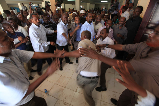 Members of the Somali parliament fight after majority voted against the Speaker of the Parliament Sharif Hassan Sheikh Aden (not pictured) in southern Mogadishu, December 21, 2011. A total of 287 out of the 290 legislators attending the session voted against the speaker. (Photo by Feisal Omar/Reuters)