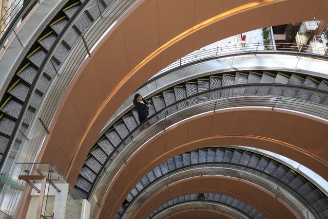 A man rides a spiral elevator in a new shopping mall in Shanghai, China March 17, 2015. (Photo by Aly Song/Reuters)
