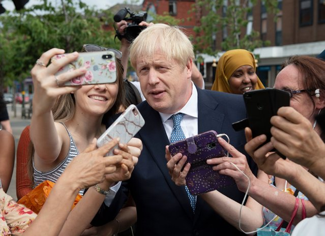 British Prime Minister Boris Johnson visits North Road, Harbourne on July 26, 2019 in Birmingham, England. (Photo by Geoff Pugh – WPA Pool/Getty Images)