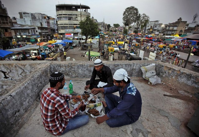 Indian Muslims breaks their fast in Ahmadabad, India, Monday, June 29, 2015. Muslims across the world are observing the holy fasting month of Ramadan, where they refrain from eating, drinking and smoking from dawn to dusk. (Photo by Ajit Solanki/AP Photo)