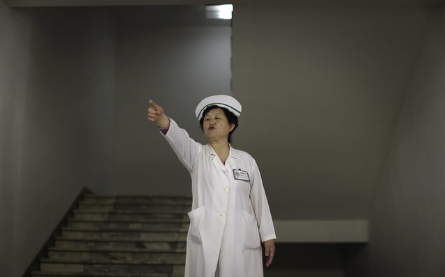 A nurse directs foreign journalists at the Pyongyang Maternity Hospital during a press tour on Saturday, May 7, 2016 in Pyongyang, North Korea. (Photo by Wong Maye-E/AP Photo)