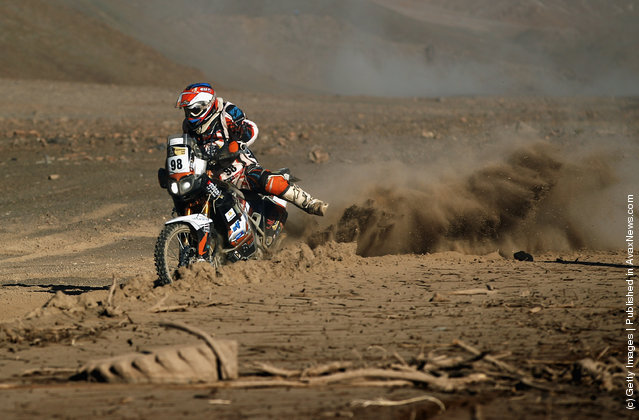 Christophe Blondeau of France and team Franroc struggles in the mud during stage eight of the 2012 Dakar Rally