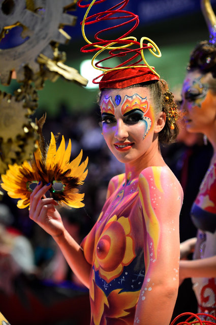 "A model waits for the rating of the jury during the ""Body Painting"" contest of the OMC Hairworld World Cup on May 4, 2014 in Frankfurt am Main, Germany. (Photo by Thomas Lohnes/Getty Images)"