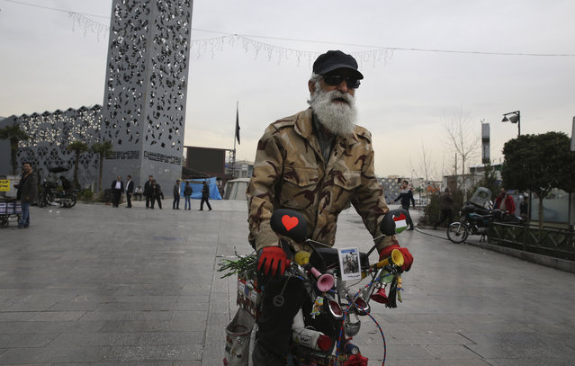 An Iranian man rides a decorated bicycle in Imam Hussein Square, central Tehran, Iran, Sunday, February 28, 2016. (Photo by Vahid Salemi/AP Photo)