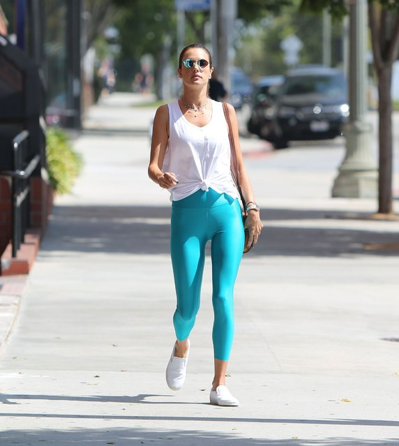 Leggy supermodel Alessandra Ambrosio puts her flawless figure on full display as she dons a pair of eye-popping neon yoga pants as she hits the gym in Brentwood, California on September 17 2019. The 38-year-old recently enjoyed a fun trip to NYC for fashion week with her daughter Anja. (Photo by X17/SIPA Press)