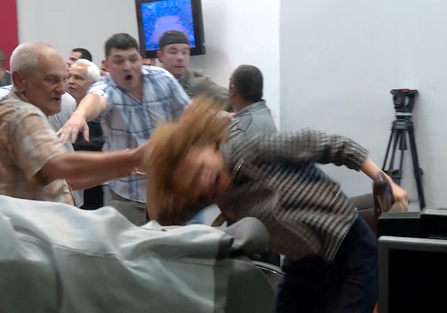 """Social Democrat party's vice president Radmila Sekerinska has her hair violently pulled, as supporters of the country's dominant conservative party invaded parliament, in Skopje, Macedonia, Thursday April 27, 2017. Police said over 100 people were injured during the Thursday night violence inside and outside parliament that followed the election of a new parliament speaker. Sekerinska said she required three stitches and injured her neck when two individuals attacked her inside parliament. Television footage from Thursday night showed a man grabbing her by the hair and twisting her around violently during the melee. """"We were more shocked than afraid. I cannot forget the faces of those who attacked me"""", Sekerinska told The Associated Press Friday. (Photo by Radio Free Europe via AP Photo)"""