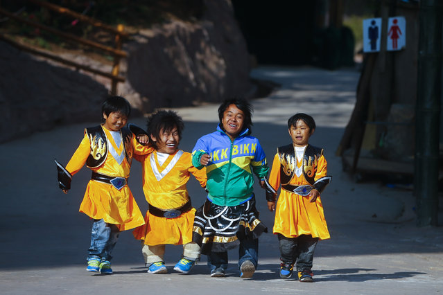 """(L-R) """"Dwarf Empire"""" cast members 21-year-old Du Zhuang, Zhang Jie Min, Li Ying' An and 22-year-old Shu Chen Jiao are seen before going on stage at the Dwarf Empire theme park outside Kunming, China's Yunnan province, 04 April 2013. (Photo by Diego Azubel/EPA)"""