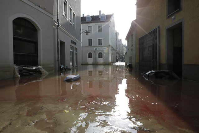 Heating oil is seen on water in the flooded center of Passau, June 7, 2013.  REUTERS/Michaela Rehle