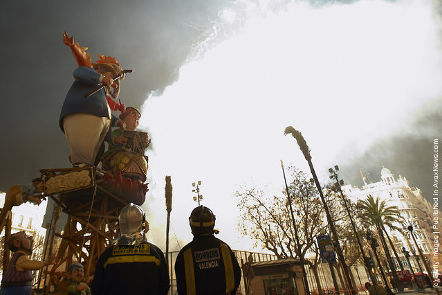 Firemen look on Combustible 'Ninot' caricatures prepared to burn during the last day of the 'Fallas' festival on March 19, 2012 in Valencia, Spain