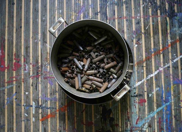 A pan with cartridges brought from the frontline in eastern Ukraine, is seen in a studio of Ukrainian artist Dariya Marchenko, in Kiev, July 22, 2015. (Photo by Gleb Garanich/Reuters)