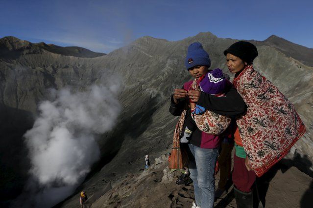 Hindu worshippers stand on top of the crater of Mount Bromo as they attend the Kasada Festival in Probolinggo, Indonesia's East Java province, August 1, 2015. (Photo by Reuters/Beawiharta)