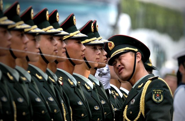 Chinese honour guards prepare for the arrival of Myanmar President U Thein Sein and Chinese President Xi Jinping during a welcome ceremony outside the Great Hall of the People in Beijing on June 27,2014. U Thein Sein is on a visit to China from June 27 to 30. (Photo by Wang Zhao/AFP Photo)