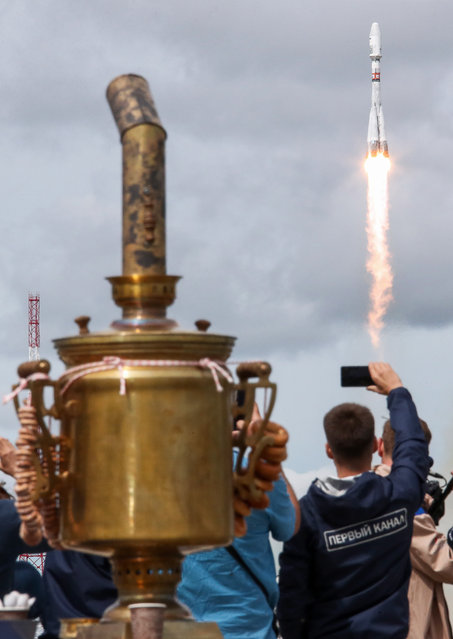 A Soyuz-2.1b rocket booster with a Fregat upper stage carrying a Meteor-M 2-2 weather satellite and 32 secondary payload spacecraft blasts off from a launch pad at the Vostochny Cosmodrome in Amur Region, Russia on July 5, 2019. (Photo by Valery Sharifulin/TASS)