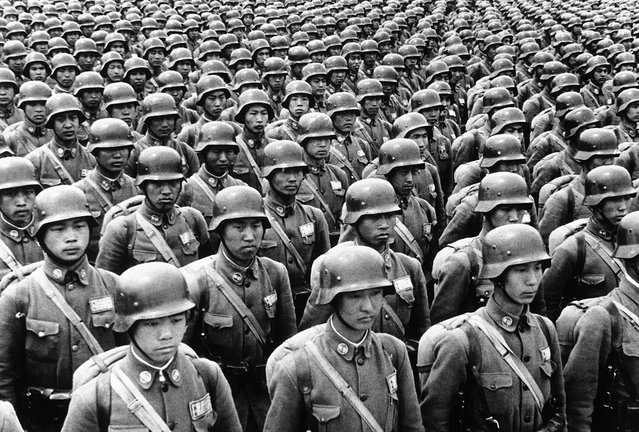 Entering their fourth year of war against Japan, Chinese military forces were strengthening their air force, producing their own armaments, and training their officers in the methods of modern war. Here, Chinese cadets in full battle dress, they favor the German type of steel helmet, on parade somewhere in China, on July 11, 1940