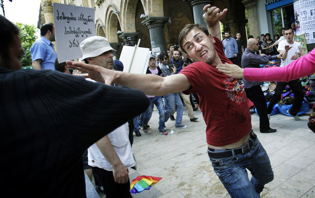 A gay rights activist, right, clashes with an Orthodox Christian activist in Tbilisi, Georgia