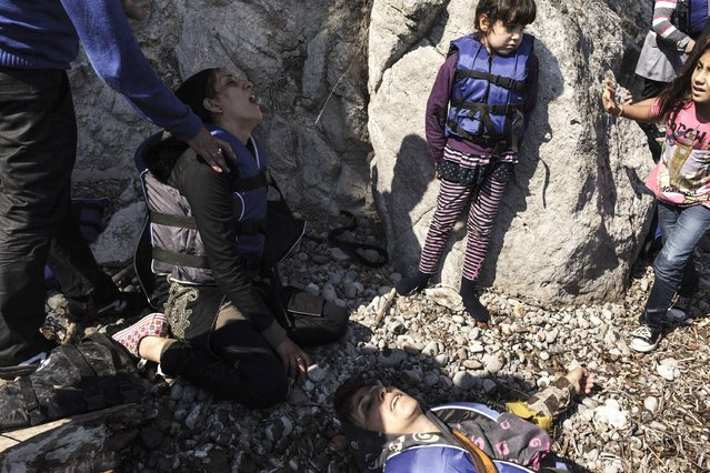 Women migrants and children from Syria take a rest as they arrive on a beach of the Greek island of Lesbos, after crossing on an inflatable boat with 35 people, the Aegean Sea between Turkey and Greece, on August 12, 2015. Some 124,000 people, almost all of them fleeing war and persecution in Syria, Afghanistan and Iraq, have come ashore since the beginning of the year – a 750-percent increase from the same period last year, the UN refugee agency said on August 7. (Photo by Achilleas Zavallis/AFP Photo)