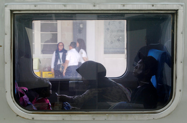 A woman gives a drink to a child inside a train as they are making their way back to their hometowns to celebrate Eid al-Fitr, a Muslim holiday to mark the end of Ramadan, at Senen Train Station in Jakarta, Indonesia, June 30, 2016. (Photo by Iqro Rinaldi/Reuters)