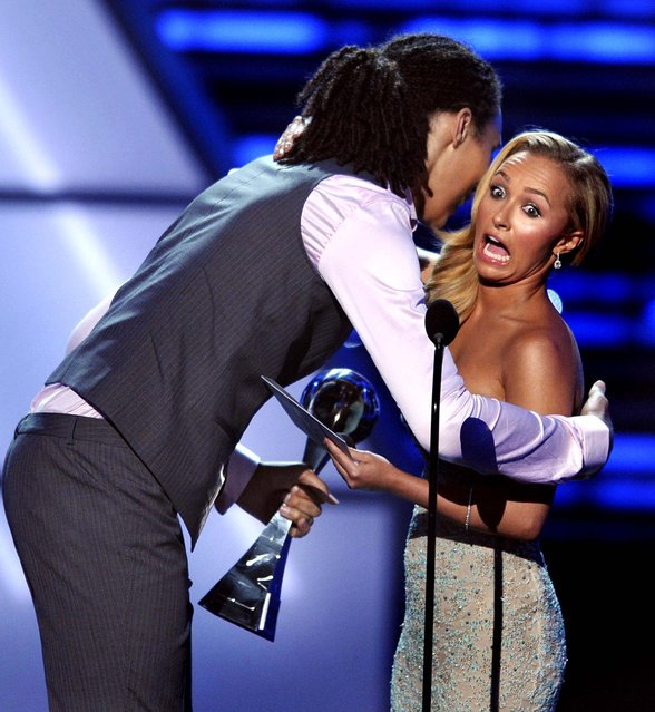 ESPY Awards 2012: American actress, singer and model Hayden Panettiere reacts as she's hugged by Brittney Griner after presenting her with the award for best female athlete