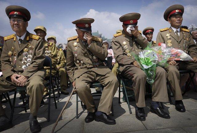 North Korean war veterans express varying degrees of emotion as they watch a parade celebrating the anniversary of the Korean War, Sunday, July 27, 2014, in Pyongyang, North Korea. (Photo by Wong Maye-E/AP Photo)