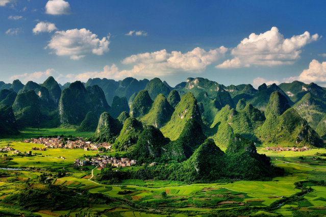 File photo taken on July 24, 2011 shows the scenery of karst landform in Dacai Township under Maonan Autonomous County of Huaijiang, south China's Guangxi Zhuang Autonomous Region. The World Heritage Committee on Monday inscribed an extension of South China Karst, a natural World Heritage Site since 2007, into the UNESCO's World Heritage List. (Photo by Wang Xiufa/Xinhua)