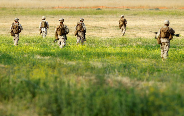 U.S. Marines head out on a patrol as part of Rim of the Pacific (RIMPAC) 2016 exercises held at Camp Pendleton, California United States, July 13, 2016. (Photo by Mike Blake/Reuters)