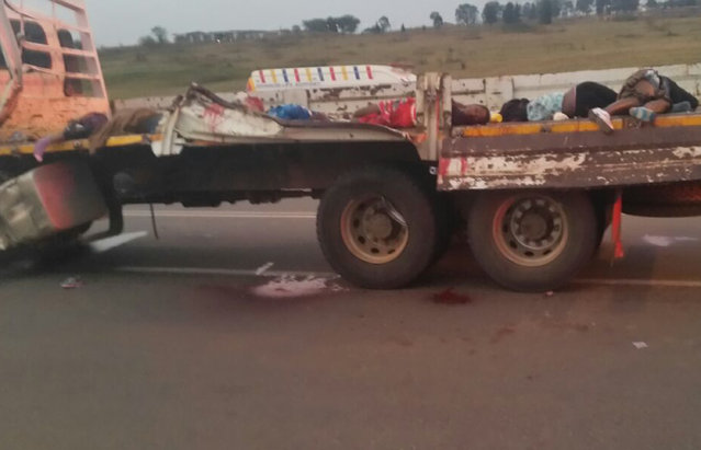 Dead bodies lay on the back of a truck Saturday August 29, 2015 near Swaziland's capital Mbabane after tens  of girls and young women were killed in a crash while traveling to a famous traditional festival Friday. The truck they were traveling in collided with another vehicle the Swaziland Solidarity Network said in a statement. (Photo by AP Photo)