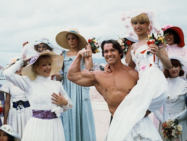 Picture taken 19th May 1977 of American actor Arnold Schwarzenegger during the 38th Cannes film festival. The actor presented Pumping Iron, a documentary which spreads his fame beyond bodybuilding circles. Arnold Schwarzenegger was born 30th June 1947 in the small isolated village of Graz, Austria. Now, he is chairman of the Inner-City Games Foundation, this program covers 10 city's and is continuing to grow. He poses 21th June 2003, new threat to beleaguered California governor. (Photo by AFP Photo)