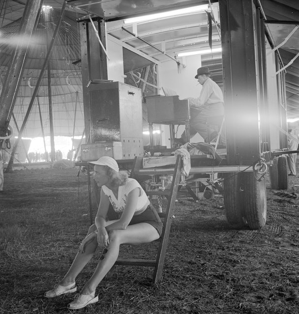 A circus girl sitting on a ladder during a rehearsal for the Ringling Bros. and Barnum & Bailey Circus in Sarasota, FL in 1949. (Photo By Nina Leen/Time Life Pictures/Getty Images)