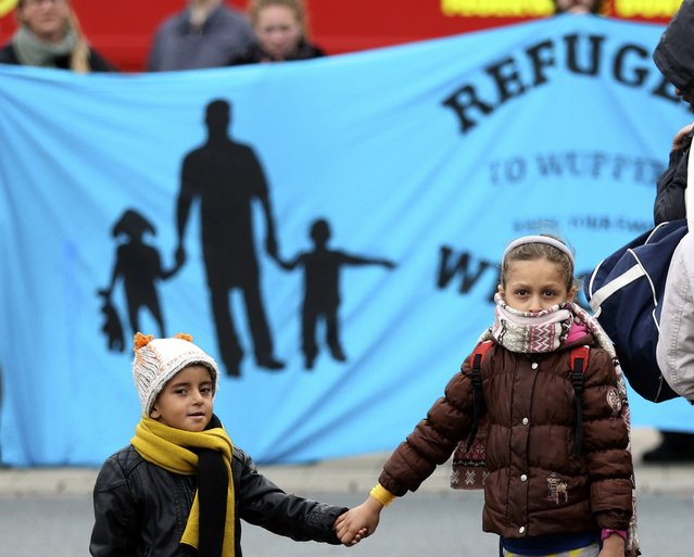 Migrants walk to a registration centre after their arrival at the main railway station in Dortmund, Germany September 6, 2015. (Photo by Ina Fassbender/Reuters)