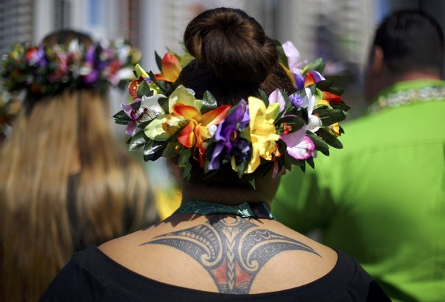 A tattoo is seen on the back of weightlifter Luisa Peters (COK) of Cook Islands during the welcoming ceremony for the country's contingent in Rio de Janeiro, Brazil on August 4, 2016. (Photo by Ivan Alvarado/Reuters)