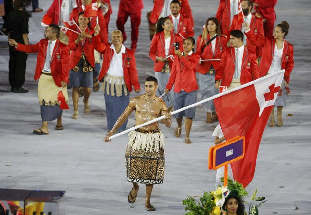 2016 Rio Olympics, Opening ceremony, Maracana, Rio de Janeiro, Brazil on August 5, 2016. Flagbearer Pita Nikolas Taufatofua (TGA) of Tonga leads his contingent during the athletes' parade at the opening ceremony. (Photo by Stoyan Nenov/Reuters)