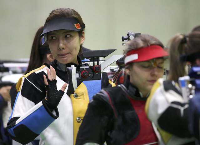 2016 Rio Olympics, Shooting, Preliminary, Women's 10m Air Rifle Qualification, Olympic Shooting Centre, Rio de Janeiro, Brazil on August 6, 2016. Du Li (CHN) of China (PRC) reacts. (Photo by Edgar Garrido/Reuters)