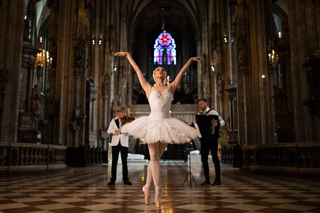 Russian born Austrian violinist Yury Revich performs a Stradivari viola next to Maria Yakovleva, Russian ballet dancer and First Soloist of the Vienna State Ballet of the Vienna State Opera, during the video recording of the Dreamland charity online concert at the Saint Stephen's Cathedral in Vienna, Austria, 10 May 2020 (issued on 15 May 2020). The Dreamland charity online concert aims to collect donations for hospitals in Milan, Naples and Rome, Italy, to fight the spread of the SARS-CoV-2 coronavirus, which causes the COVID-19 disease. The concert will be streamed on 17 May 2020. (Photo by Max Brucker/EPA/EFE)