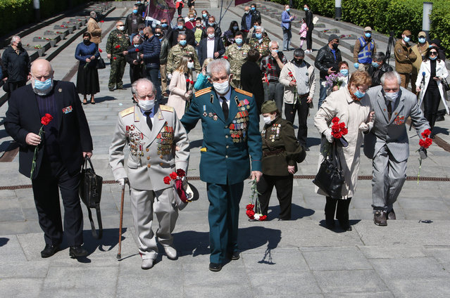 Ukranian veterans attend an event commemorating World War II (WWII) martyrs on the occasion of Victory in Europe Day at the Park of Eternal Glory in Kiev, Ukraine, May 9, 2020. (Photo by Xinhua News Agency/Rex Features/Shutterstock)