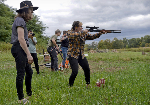 In this October 8, 2017, photo, Zora Gussow, center, aims a shotgun during a training session of the Trigger Warning Queer & Trans Gun Club in a field in Victor, N.Y. A dozen shooters in a field in upstate New York does not exactly represent a vanguard of a newly armed left. But the group is not alone. Jake Allen, who helped form the group, said there is another Trigger Warning chapter in Atlanta and he has received inquiries from people in about 10 other cities. (Photo by Adrian Kraus/AP Photo)