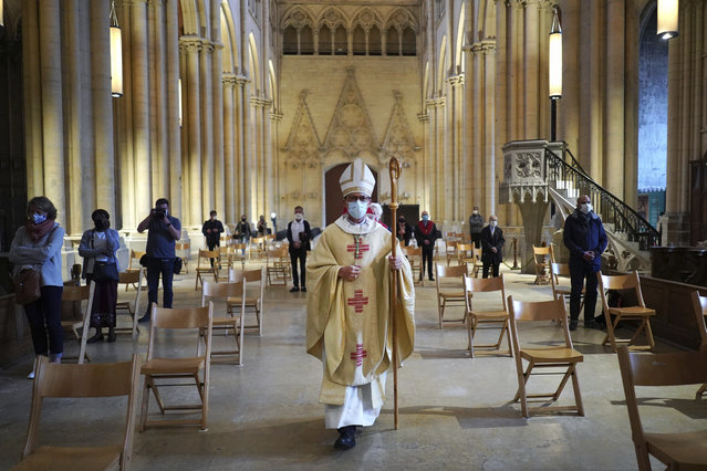 Bishop of Lyon Emmanuel Gobilliard leads mass, the first since lockdown restrictions were introduced to curb the spread of the coronavirus, at the Saint-Jean Cathedral, in Lyon, central France, Saturday, May 23, 2020. France allowed religious services to resume Saturday after a legal challenge to the government's ban on such gatherings. (Photo by Laurent Cipriani/AP Photo)