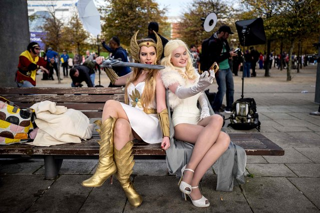 Cosplayers dressed as She- Ra and Emma Frost pose for a photograph at the MCM Comic Con at ExCeL exhibition centre in London on October 28, 2017. (Photo by Tolga Akmen/AFP Photo)