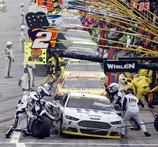 Brad Keselowski (2) leads cars in pit row during the NASCAR Sprint Cup series auto race at New Hampshire Motor Speedway, Sunday, September 21, 2014, in Loudon, N.H. (Photo by Jim Cole/AP Photo)