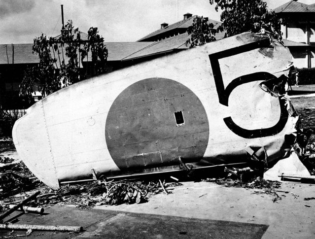 The wing of a Japanese bomber shot down on the grounds of the Naval Hospital in Honolulu on December 7, 1941. (Photo by Associated Press)