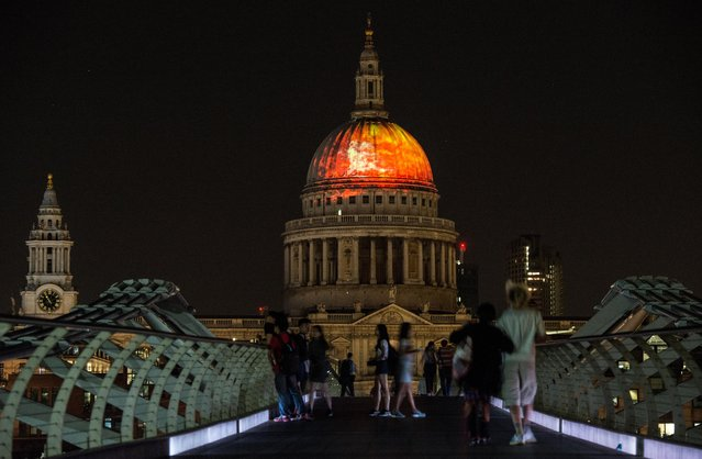 Flames are projected on to the dome of St Paul's Cathedral, as seen from the Millennium Bridge, as a rehearsal for the London's Burning Festival which will take place on Sunday commemorating the Great Fire of London at St Paul's Cathedral on August 30, 2016 in London, England. The anniversary of the 1966 Great Fire of London will be celebrated in the capital with events including the flames on St. Pauls Cathedral and a 120 metre long wooden sculpture of 17th century London which will be set on fire. (Photo by Chris J. Ratcliffe/Getty Images)