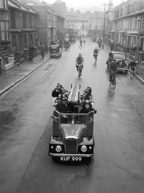 On the streets of Brighton in Sussex, a fire engine, complete with a crew of children, just half the size of a real fire engine, and complete in every detail, with bells, ladders and hoses. 5th May 1951. (Photo by Chris Ware/Keystone Features)