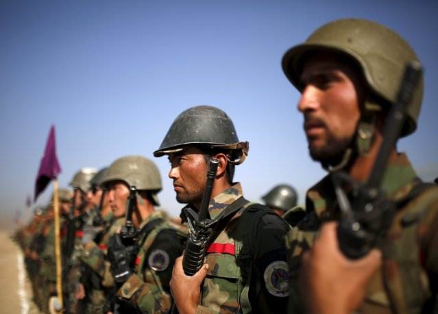 Afghan National Army (ANA) officers stand at attention during a training exercise at the Kabul Military Training Centre in Afghanistan October 7, 2015. (Photo by Ahmad Masood/Reuters)