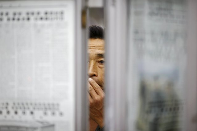 A man reads newspapers displayed inside a subway station visited by foreign reporters during a government organised tour in Pyongyang, North Korea, October 9, 2015. (Photo by Damir Sagolj/Reuters)