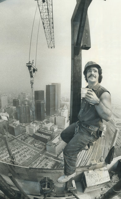 Yvon Rainville drinks coffee on the CN Tower, one of Canada's landmarks, 26 September 1973. (Photo by Boris Spremo/Toronto Star via Getty Images)