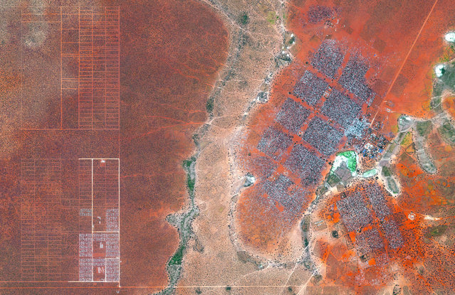 Hagadera, seen here on the right, is the largest section of the Dadaab refugee camp in northern Kenya and is home to 100,000 refugees. To cope with the growing number of displaced Somalis arriving at Dadaab, the UN has begun moving people into a new area called the LFO extension, seen here on the left. Dadaab is the largest refugee camp in the world with an estimated total population of 400,000. (Photo by Benjamin Grant/Penguin Random House)