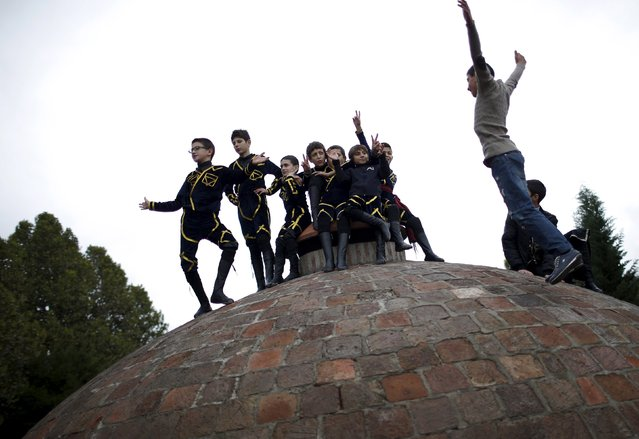 Young dancers play on the roof of a sulphite bath before their performance during the annual Tbilisoba festival, celebrating Tbilisi City Day in Tbilisi, Georgia, October 17, 2015. (Photo by David Mdzinarishvili/Reuters)